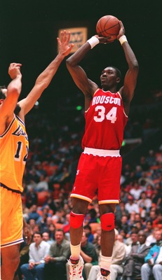 28 DEC 1993:  HOUSTON ROCKETS CENTER HAKEEM OLAJUWON PUTS A SHOT UP AGAINST THE LAKER''S VLADE DIVAC. Mandatory Credit: Glenn Cratty/ALLSPORT
