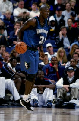 15 Feb 1999:  Kevin Garnett #21 of the Minnesota Timberwolves in action during the game against the Golden State Warriors at the Oakland Arena in Oakland, California. The Warriors defeated the Timberwolves 101-99.  Mandatory Credit: Todd Warshaw  /Allspor
