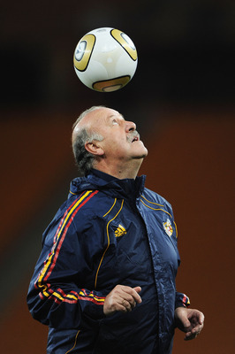 JOHANNESBURG, SOUTH AFRICA - JULY 10:  Vicente del Bosque Head Coach of Spain controls a ball with his head during a Spain training session, ahead of the 2010 FIFA World Cup Final, at Soccer City Stadium on July 10, 2010 in Johannesburg, South Africa.  (P