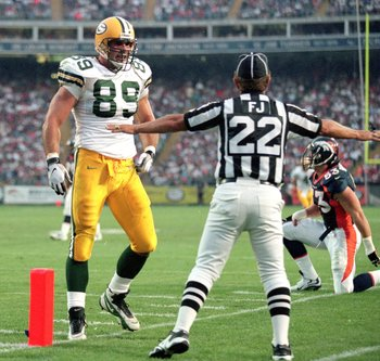 24 Aug 1998: Mark Chmura #89 of the Green Bay Packers walks towards an official during a game against the Denver Broncos at the Mile High Stadium in Denver, Colorado. The Broncos defeated the Packers 34-31.