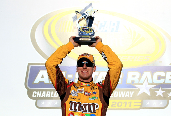 CHARLOTTE, NC - MAY 20:  Kyle Busch, driver of the #18 M&M's Toyota, celebrates setting the pole position during qualifying for the NASCAR Sprint All-Star Race at Charlotte Motor Speedway on May 20, 2011 in Charlotte, North Carolina.  (Photo by Streeter L