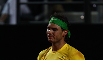 ROME, ITALY - MAY 15:  Rafael Nadal of Spain shows his dejection during the final against Novak Djokovic of Serbia during day eight of the Internazoinali BNL D'Italia at the Foro Italico Tennis Centre on May 15, 2011 in Rome, Italy.  (Photo by Clive Bruns
