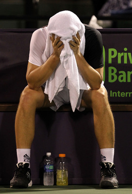KEY BISCAYNE, FL - APRIL 01:  Mikhail Youzhny of Russia put a towel over his face while playing against Robin Soderling of Switzerland during day ten of the 2010 Sony Ericsson Open at Crandon Park Tennis Center on April 1, 2010 in Key Biscayne, Florida.
