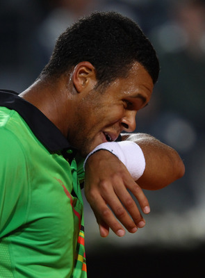 ROME, ITALY - MAY 11:  Jo-Wilfried Tsonga of France shows his dejection during his second round match against Roger Federer of Switzerland during day four of the Internazoinali BNL D'Italia at the Foro Italico Tennis Centre on May 11, 2011 in Rome, Italy.