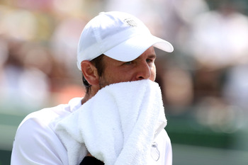KEY BISCAYNE, FL - APRIL 01:  Mardy Fish wipes his face with a towel against Novak Djokovic of Serbia during their semifinal match at the Sony Ericsson Open at Crandon Park Tennis Center on April 1, 2011 in Key Biscayne, Florida.  (Photo by Al Bello/Getty