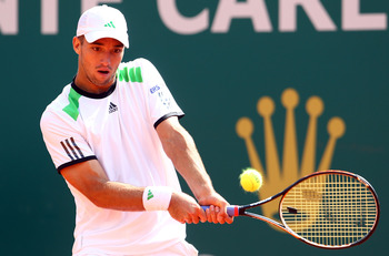 MONACO - APRIL 15:  Viktor Troicki of Serbia plays a backhand in his match against David Ferrer of Spain during Day Six of the ATP Masters Series Tennis at the Monte Carlo Country Club on April 15, 2011 in Monte Carlo, Monaco.  (Photo by Julian Finney/Get