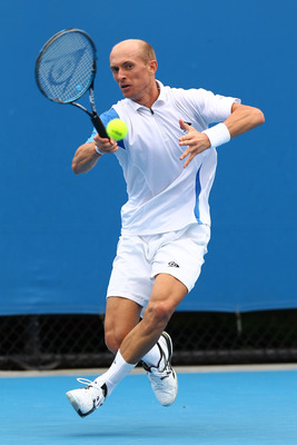 MELBOURNE, AUSTRALIA - JANUARY 17:  Nikolay Davydenko of Russia plays a forehand in his first round match against Florian Mayer of Germany during day one of the 2011 Australian Open at Melbourne Park on January 17, 2011 in Melbourne, Australia.  (Photo by
