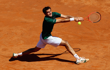 ROME, ITALY - MAY 13: Marin Cilic of Croatia stretches to play a backhand during his quarter final match against Rafael Nadal of Spain during day six of the Internazoinali BNL D'Italia at the Foro Italico Tennis Centre  on May 13, 2011 in Rome, Italy.  (P