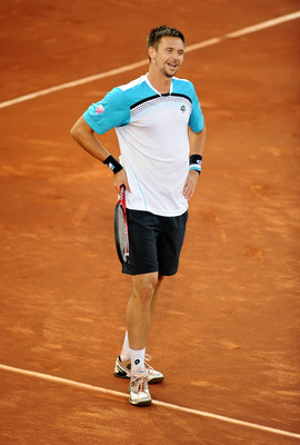 MADRID, SPAIN - MAY 06:  Robin Soderling of Sweden reacts in his match against Roger Federer of Switzerland during day seven of the Mutua Madrilena Madrid Open Tennis on May 6, 2011 in Madrid, Spain. Federer won the match in straight sets.  (Photo by Jasp