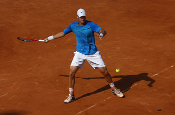ROME, ITALY - MAY 12:  Tomas Berdych of Czech Republic hits a forehand return during his third round match against Jarkko Nieminen of Finland during day five of the Internazionali BNL d'Italia at the Foro Italico Tennis Centre on May 12, 2011 in Rome, Ita