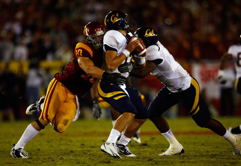 LOS ANGELES, CA - NOVEMBER 08:  Quarterback Kevin Riley #13 of the Cal Golden Bears is sacked by Brian Cushing #10 of the USC Trojans during the fourth quarter at the Memorial Coliseum on November 8, 2008 in Los Angeles, California. USC defeated Cal 17-3.