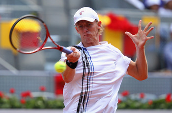 MADRID, SPAIN - MAY 04:  Kevin Anderson of South Africa plays a forehand in his match against Novak Djokovic of Serbia during day five of the Mutua Madrilena Madrid Open Tennis on May 4, 2011 in Madrid, Spain.  (Photo by Julian Finney/Getty Images)