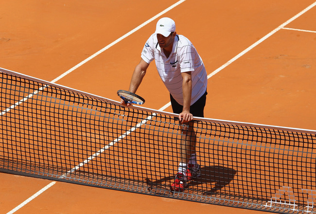 ROME, ITALY - MAY 09:  Andy Roddick of the USA shows his dejection as he leans on the net during his first round match against Gilles Simon of France during day two of the Internazoinali BNL D'Italia at the Foro Italico Tennis Centre on May 9, 2011 in Rom
