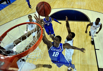 HOUSTON, TX - APRIL 02:  Brandon Knight #12 of the Kentucky Wildcats goes to the hoop against Alex Oriakhi #34 of the Connecticut Huskies during the National Semifinal game of the 2011 NCAA Division I Men's Basketball Championship at Reliant Stadium on Ap