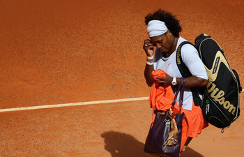 MADRID, SPAIN - MAY 11:  Serena Williams of the USA shows her dejection as she leaves the court after retiring injured from her first round match against Francesca Schiavone of Italy during the Madrid Open tennis tournament at the Caja Magica on May 11, 2