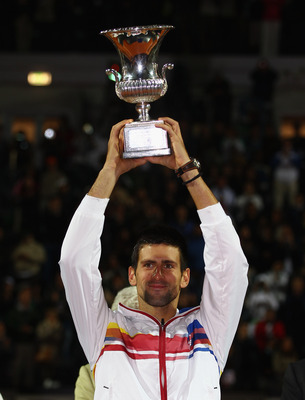 ROME, ITALY - MAY 15:  Novak Djokovic of Serbia holds the trophy aloft after his victory in the final against Rafael Nadal of Spain during day eight of the Internazoinali BNL D'Italia at the Foro Italico Tennis Centre on May 15, 2011 in Rome, Italy.  (Pho