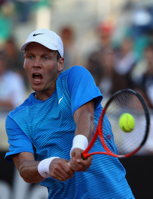 ROME, ITALY - MAY 13:  Tomas Berdych of Czech Republic plays a backhand during his quarter final match against Richard Gasquet of France during day six of the Internazoinali BNL D'Italia at the Foro Italico Tennis Centre  on May 13, 2011 in Rome, Italy.