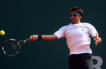 MONACO - APRIL 12:  Janko Tipsarevic of Serbia plays a forehand in his match against Feliciano Lopez of Spain during Day Three of the ATP Masters Series Tennis at the Monte Carlo Country Club on April 12, 2011 in Monte Carlo, Monaco.  (Photo by Julian Fin