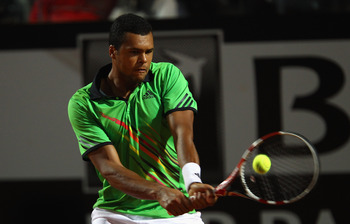 ROME, ITALY - MAY 11: Jo-Wilfried Tsonga of France  plays a backhand during his second round match against Roger Federer of Switzerland during day four of the Internazoinali BNL D'Italia at the Foro Italico Tennis Centre on May 11, 2011 in Rome, Italy.  (