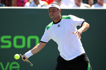KEY BISCAYNE, FL - MARCH 26:  Marcos Baghdatis of Cyprus returns against Oliver Rochus of Belgium during the Sony Ericsson Open at Crandon Park Tennis Center on March 26, 2011 in Key Biscayne, Florida.  (Photo by Al Bello/Getty Images)