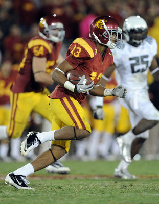 LOS ANGELES, CA - OCTOBER 30:  Robert Woods #13 of the USC Trojans runs with the ball against the Oregon Ducks at Los Angeles Memorial Coliseum on October 30, 2010 in Los Angeles, California.  (Photo by Harry How/Getty Images)