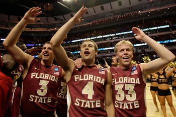 CHICAGO, IL - MARCH 20:  Luke Loucks #3, Deividas Dulkys #4 and Joey Moreau #33 of the Florida State Seminoles celebrate their 71-57 victory over the Notre Dame Fighting Irish during the third round of the 2011 NCAA men's basketball tournament at the Unit