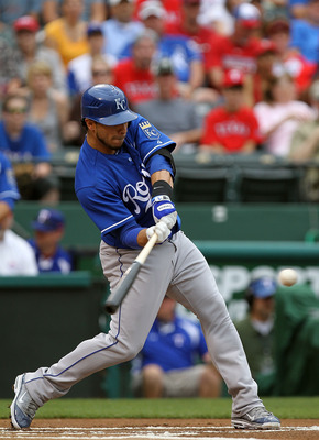 ARLINGTON, TX - APRIL 24:  Mike Aviles #13 of the Kansas City Royals hits a single against the Texas Rangers at Rangers Ballpark in Arlington on April 24, 2011 in Arlington, Texas.  (Photo by Ronald Martinez/Getty Images)
