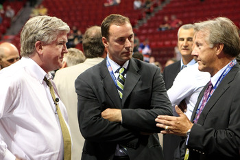 MONTREAL, QC - JUNE 26:  President & General Manager Brian Burke (L) and head coach Ron Wilson (R) of the Toronto Maple Leafs talk with Genral Manager Joe Nieuwendyk of the Dallas Stars prior to the first round of the 2009 NHL Entry Draft at the Bell Cent