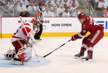 GLENDALE, AZ - APRIL 16:  Matthew Lombardi #15 of the Phoenix Coyotes scores a second period goal through the legs of goaltender Jimmy Howard #35 of the Detroit Red Wings in Game Two of the Western Conference Quarterfinals during the 2010 NHL Stanley Cup