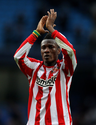 MANCHESTER, ENGLAND - APRIL 03:  Asamoah Gyan of Sunderland applauds the fans at the end of the Barclays Premier League match between Manchester City and Sunderland at the City of Manchester Stadium on April 3, 2011 in Manchester, England.  (Photo by Alex
