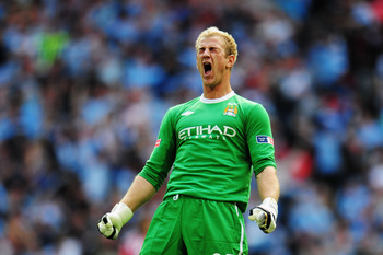 LONDON, ENGLAND - MAY 14:  Joe Hart of Manchester City celebrates as his team score during the FA Cup sponsored by E.ON Final match between Manchester City and Stoke City at Wembley Stadium on May 14, 2011 in London, England.  (Photo by Shaun Botterill/Ge