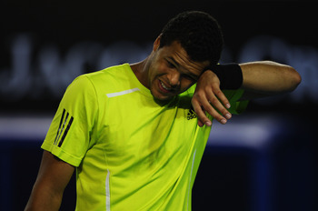 MELBOURNE, AUSTRALIA - JANUARY 29:  Jo-Wilfried Tsonga of France wipes is forehead in his semifinal match against Roger Federer of Switzerland during day twelve of the 2010 Australian Open at Melbourne Park on January 29, 2010 in Melbourne, Australia.  (P
