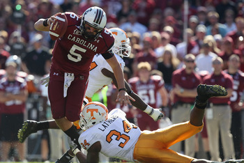 COLUMBIA, SC - OCTOBER 30:  Stephen Garcia #5 of the South Carolina Gamecocks gets away from Herman Lathers #34 of the Tennessee Volunteers during their game at Williams-Brice Stadium on October 30, 2010 in Columbia, South Carolina.  (Photo by Streeter Le