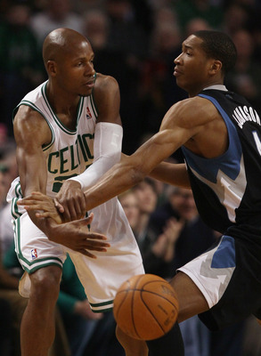 BOSTON, MA - JANUARY 03:  Ray Allen #20 of the Boston Celtics passes the ball under pressure from Wesley Johnson #4 of the Minnesota Timberwolves on January 3, 2011 at the TD Garden in Boston, Massachusetts. NOTE TO USER: User expressly acknowledges and a