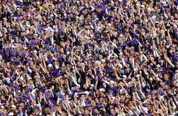 MANHATTAN, KS - OCTOBER 16:  Kansas State Wildcats fans cheer their team as they take a lead on an interception against the Oklahoma Sooners in the third quarter on October 16, 2004 at KSU Stadium in Manhattan, Kansas. The Sooners won 31-21.  (Photo by Br