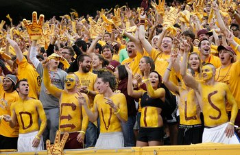 TEMPE, AZ - NOVEMBER 28:  Fans of the Arizona State Sun Devils cheer during the college football game against the Arizona Wildcats at Sun Devil Stadium on November 28, 2009 in Tempe, Arizona.  The Wildcats defeated the Sun Devils 20-17.  (Photo by Christi