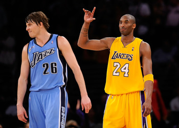 LOS ANGELES, CA - APRIL 27:  Kobe Bryant #24 of the Los Angeles Lakers reacts as he stands alongside Kyle Korver #26 of the Utah Jazz in the fourth quarter of Game Five of the Western Conference Quarterfinals during the 2009 NBA Playoffs at Staples Center