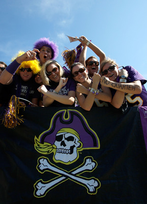 GREENVILLE, NC - SEPTEMBER 05:  Fans of the East Carolina Pirates celebrates before the start of their game against the Appalachian State Mountaineers at Dowdy-Ficklen Stadium on September 5, 2009 in Greenville, North Carolina.  (Photo by Streeter Lecka/G