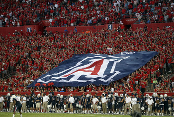TUCSON, AZ - OCTOBER 09:  A flag for the Arizona Wildcats is held by fans during the college football game against the Oregon State Beavers at Arizona Stadium on October 9, 2010 in Tucson, Arizona. The Beavers defeated the Wildcats 29-27.  (Photo by Chris