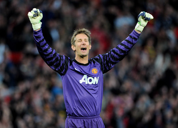 MANCHESTER, ENGLAND - MAY 04:  Edwin van der Sar of Manchester United celebrates after his team's second goal during the UEFA Champions League Semi Final second leg match between Manchester United and Schalke at Old Trafford on May 4, 2011 in Manchester,