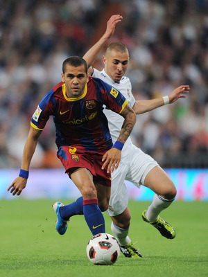MADRID, SPAIN - APRIL 16:  Daniel Alves (L) of Barcelona duels for the ball with Karim Benzema of Real Madrid during the la Liga match between Real Madrid and Barcelona at Estadio Santiago Bernabeu on April 16, 2011 in Madrid, Spain.  (Photo by Jasper Jui