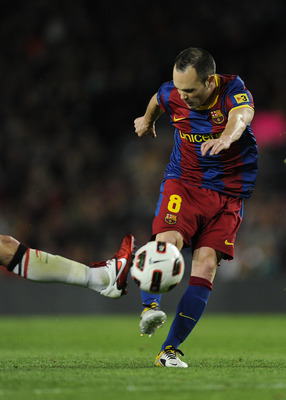 BARCELONA, SPAIN - APRIL 23:  Andres Iniesta of FC Barcelona (C) shoots towards goal during the La Liga match between Barcelona and CA Osasuna at Camp Nou Stadium on April 23, 2011 in Barcelona, Spain. Barcelona won 2-0.  (Photo by David Ramos/Getty Image