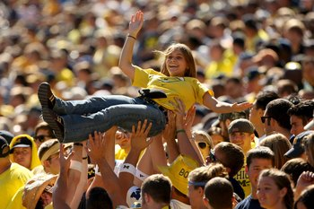 ANN ARBOR, MI - SEPTEMBER 19:  Members of the Michigan Wolverines student section lift a fan to celebrate a score against the Eastern Michigan Eagles at Michigan Stadium on September 19, 2009 in Ann Arbor, Michigan. Michigan won 45-17.  (Photo by Stephen