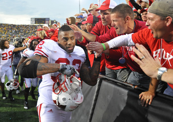 IOWA CITY, IA - OCTOBER 23: Running back John Clay #32 of the Wisconsin Badgers celebrates with fans after Wisconsin's victory over the University of Iowa at Kinnick Stadium on October 23, 2010 in Iowa City, Iowa. Wisconsin won 31-30 over Iowa. (Photo by