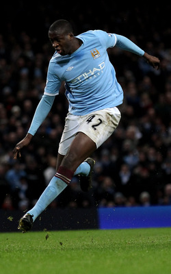 MANCHESTER, ENGLAND - JANUARY 15:  Yaya Toure of Manchester City scores his team's third goal during the Barclays Premier League match between Manchester City and Wolverhampton Wanderers at the City of Manchester Stadium on January 15, 2011 in Manchester,