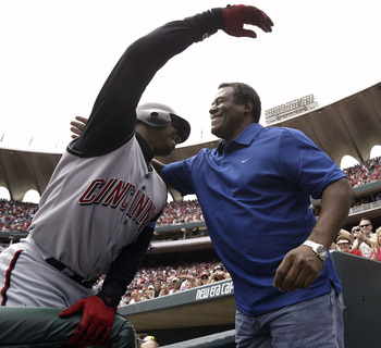 ST. LOUIS - JUNE 20:  Ken Griffey Jr. (L) #30 of the Cincinnati Reds is congratulated by his father Ken Griffey Sr. after junior hit his 500th career home run in the sixth inning against Matt Morris of the St. Louis Cardinals on June 20, 2004 at Busch Sta