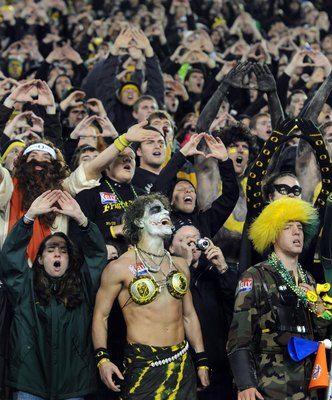 EUGENE, OR - OCTOBER 31: Oregon Ducks fans make some noise on a Halloween night game against the USC Trojans at Autzen Stadium on October 31, 2009 in Eugene, Oregon. The crowd noise at Autzen Stadium is said to be one of the loudest in the nation and repo