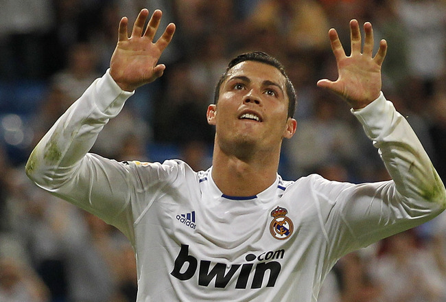 MADRID, SPAIN - MAY 10:  Cristiano Ronaldo of Real Madrid celebrates after scoring his side fourth goal during the La Liga match between Real Madrid and Getafe at Estadio Santiago Bernabeu on May 10, 2011 in Madrid, Spain.  (Photo by Angel Martinez/Getty