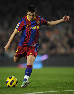 BARCELONA, SPAIN - JANUARY 02:  David Villa of Barcelona shoots towards goal during the La Liga match between Barcelona and Levante UD at Camp Nou on January 2, 2011 in Barcelona, Spain. Barcelona won 2-1.  (Photo by David Ramos/Getty Images)