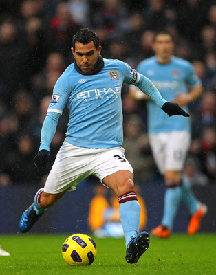 MANCHESTER, ENGLAND - FEBRUARY 05:  Carlos Tevez of Manchester City scores his second goal during the Barclays Premier League match between Manchester City and West Bromwich Albion at the City of Manchester Stadium on February 5, 2011 in Manchester, Engla